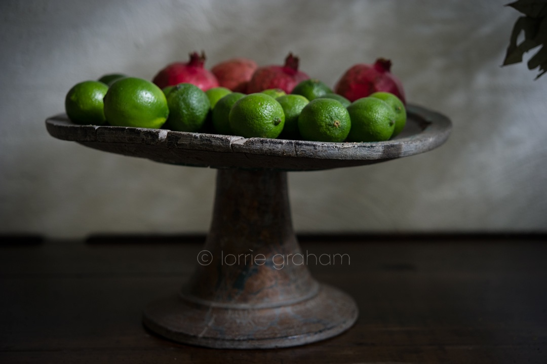 Antique Balinese Offering Platter dressed with limes and pomegranites