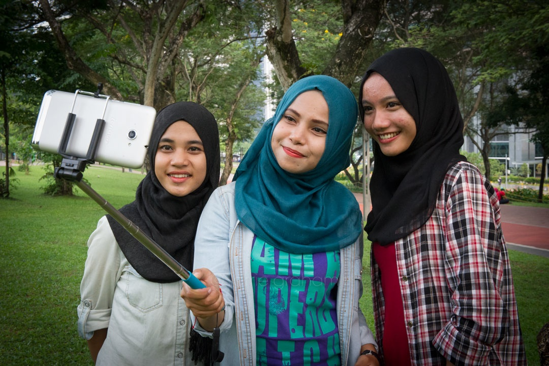 Malaysian girls with their selfie monopod, Kuala Lumpur, September 2014