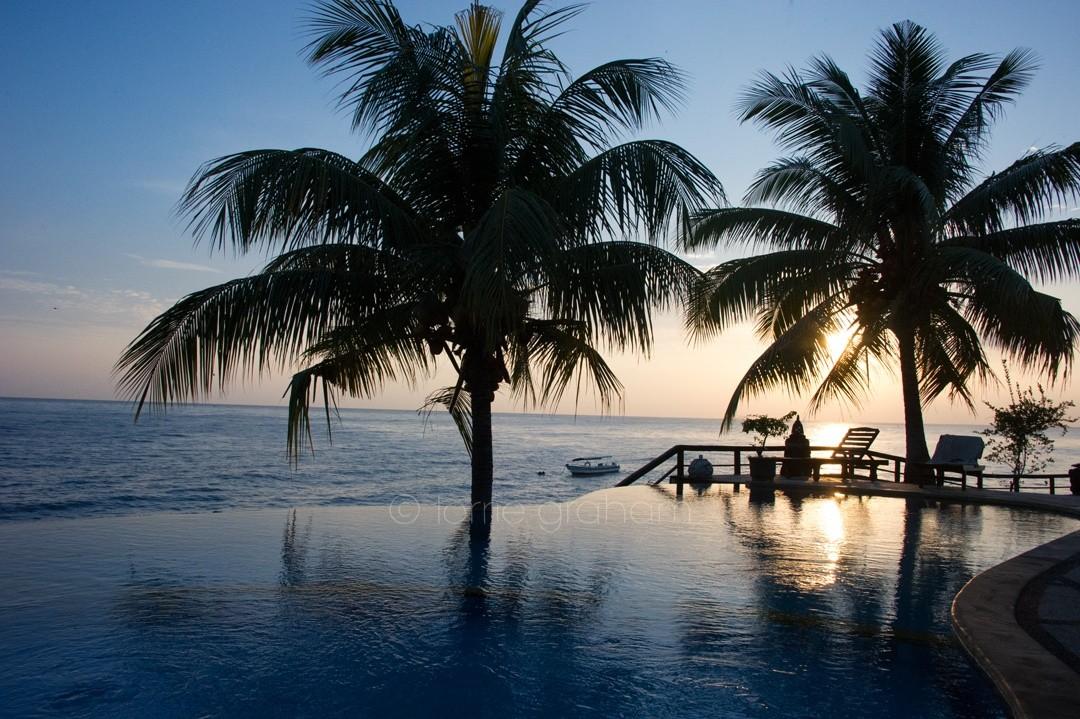 Sunrise across the pool at Batu Belah, East Bali, in the shadows of Mt Agung