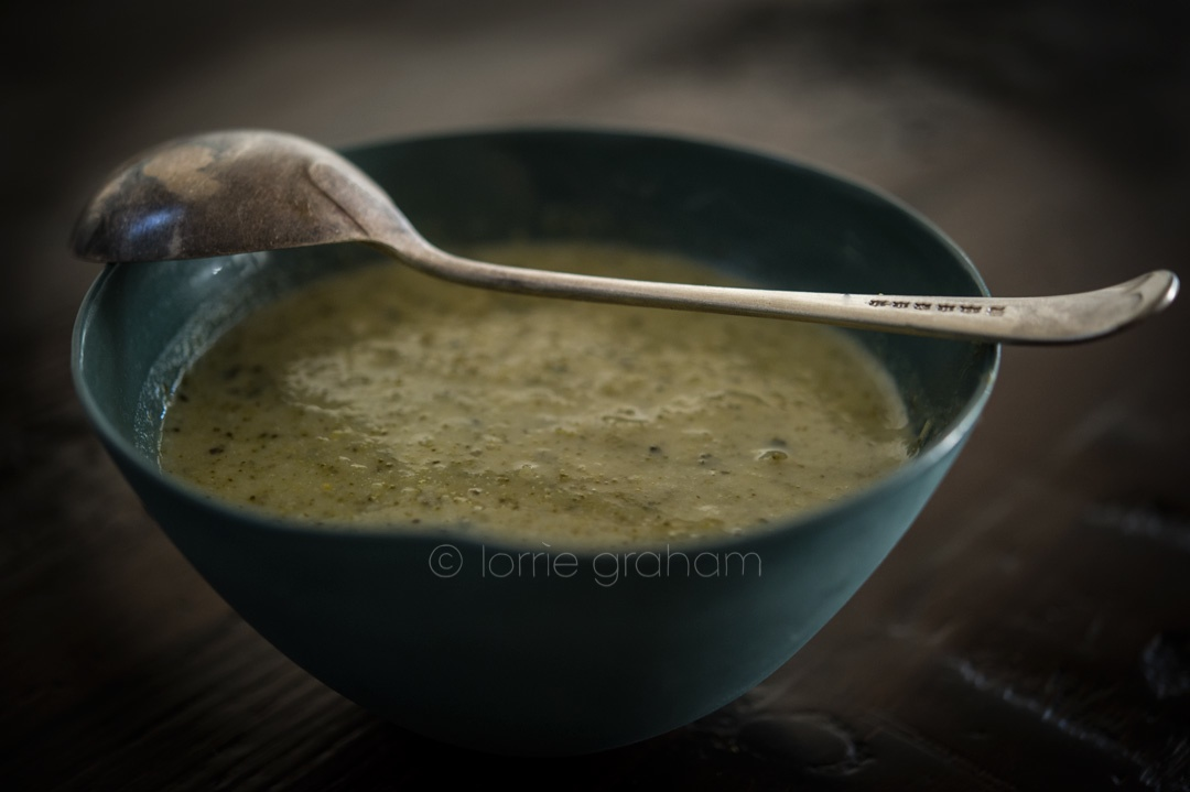 A broccoli soup served in a Mud bowl