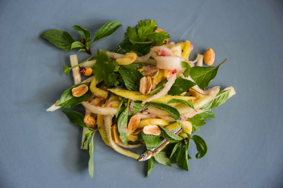 This is a photo of the Yoram Ottolenghi recipe for a delicious and refreshing summer salad of prawns and mango with mint.